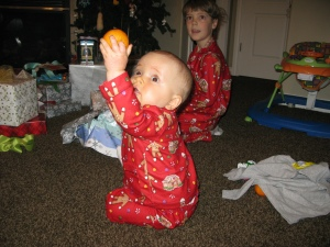 Logan had a clementine in the toe of his stocking and it was by far his favorite thing!  He carried it around and showed it off!