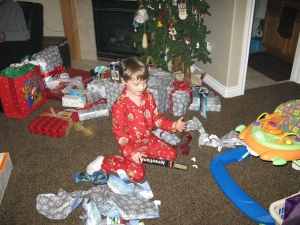 We convinced Conner to move the presents into the family room where there was more room...we really needed it!