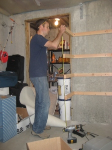 {Dave hard at work making the shelves level & beyond sturdy}