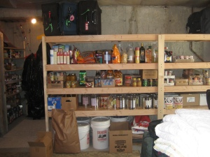 {I still need to move everything from that little room behind out on the shelves & then majoring STOCK UP on food storage}